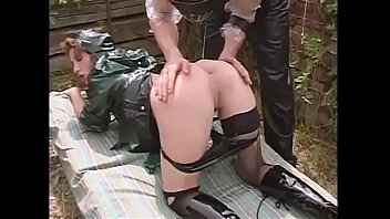 Slave kept in a cage ass fucked