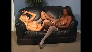 Black babe Lady Armani fucks her white girlfriend Celestia Star with a black cock strap-on with pleasure