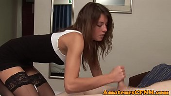 CFNM babe in stockings gives handjob