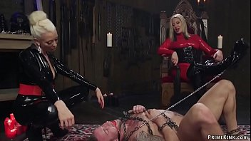 Femdoms in latex whipping man slave