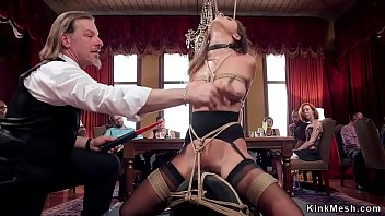 Sexy slave rides Sybian at orgy party