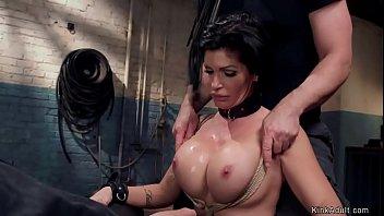Busty MILF slave sucks huge cock