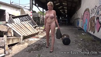 Mature Lady Sonia strips completely nude outdoors