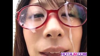 Mimi Kousaka with specs licks hard penis porn image