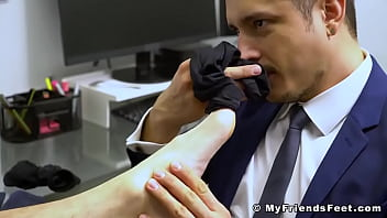 Muscular hunk Skyy Knox foot worshiped by his buddy in suit