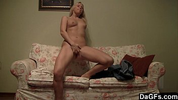 Tiny blonde makes a hot striptease on the couch