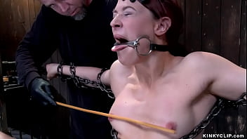 Chained ginger slave caned and toyed