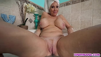 Carla Crane reveals her lush GILF tits to her grandson while taking a bath! Soon this perverted nana grabs her grandson's cock and things get ugly!