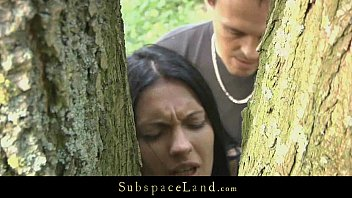 Hot brunette restrained in the woods and fucked