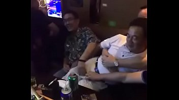 chinese daddies touch each other at KTV.