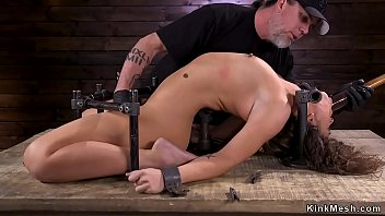 Brunette in arc bondage device 5 min
