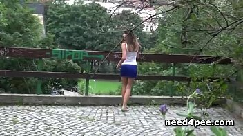 Teen amateur caught pissing on a bench at night thumbnail