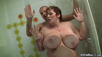 He picks up her and fucks her slippery fat body in the shower