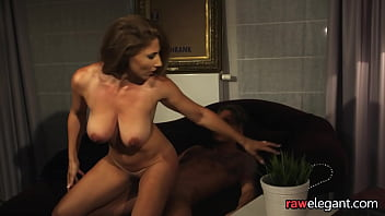 Tittyfucked cougar riding hard cock