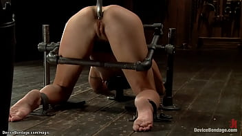 Slave in metal device on Sybian