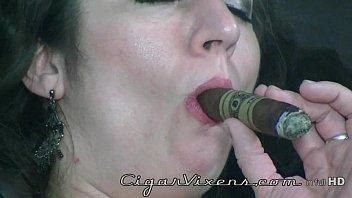 Betty Jaded SMOKES a cigar