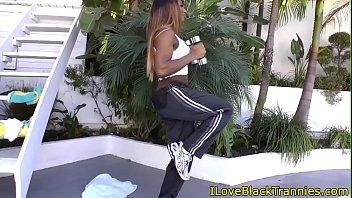 Busty ebony tgirl gives blowjob outdoors