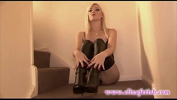 Blonde in thigh high leather high heel stiletto boots