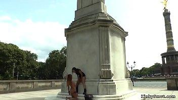 Slut licking mistress outdoor in public