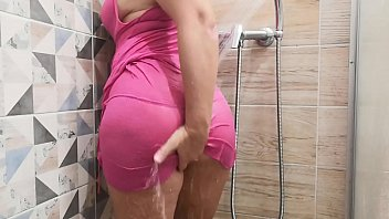 MILF teases you in a see-through dress in the shower and masturbates to a strong orgasm.