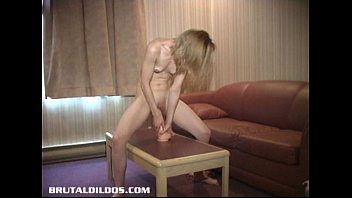 Petite blonde Natasha moaning from a big b. dildo