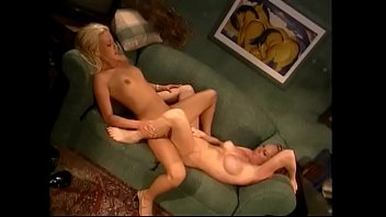 Horny lesbians with great tits lick each other's pussies in 69 position on the couch