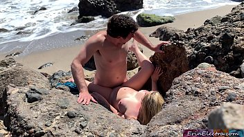 Voluptuous blonde sunbathing nude on the beach fucks passer-by - Erin Electra صورة