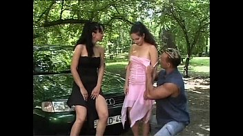 Dirty practices: a man fucking with two sluts outdoor in a wood