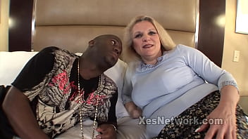 Big Booty Blonde Mature Rides a Black Cock in Interracial Video