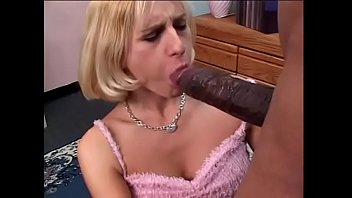 Young blonde girl loves to suck cum out of a massive black dick on her bed