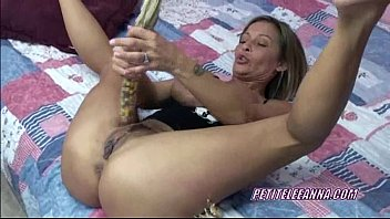 Petite Leeanna stuffs her twat with big corn cobs