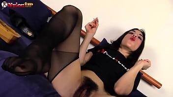 Bushy pornstar Magena Yama in stockings riding a dildo