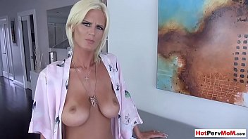 Busty MILF stepmom stops ironing to blow her stepson