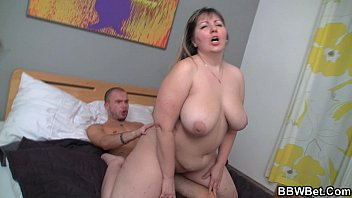 Busty plumper jumps on hard man meat