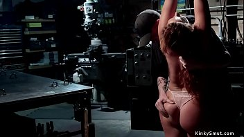 Chained brunette sub is caned