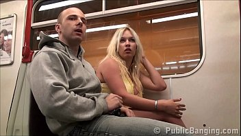 A woman with a huge natural tits in a public sex threesome in a subway train