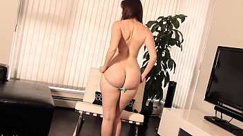 redhead strips and teases with great breasts and spreads her ass preview image