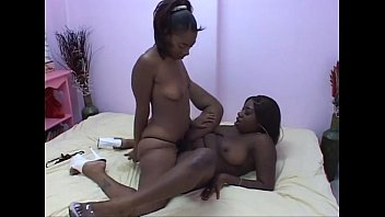 ebony lesbian enjoying hot strapon