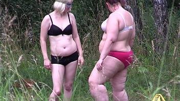 Voyeur watches mature lesbians outdoors. Amateur peeping behind the scenes. Juicy PAWG in cream walks in the woods. 19 min