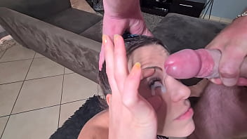 Petite whore gets her eye covered in cum after jerking off cock