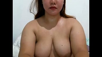 Curvy Asian girl touches herself