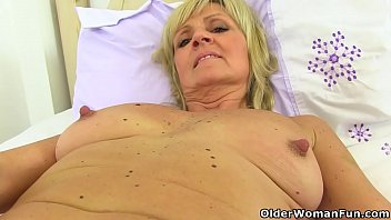 English milf Dolly gets naughty in tights