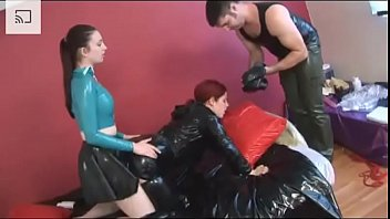 Rubber backed mackintoshes for pleasure - Slave gets fucked in a heavy latex and breathplay