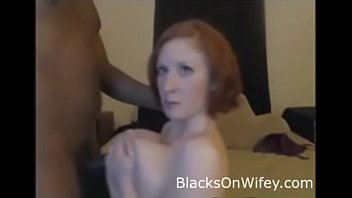 Busty Redhead Titfucks Black Cock