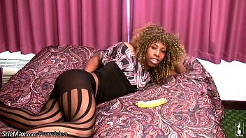 Chubby ebony tranny Blonde ebony tranny in pantyhose plays with banana and cums