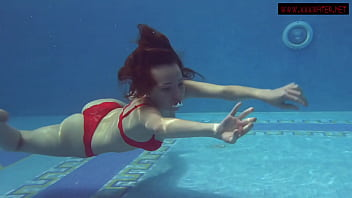 Brunette big tits babe Mia Ferrari swims in the pool