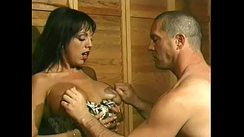 Busty dominant brunette with olive skin Angela D'Angelo told her slave to lick her feet and to be ready to take huge strap on in his chocolate eys