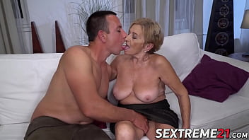 Kinky granny receives a facial after being banged