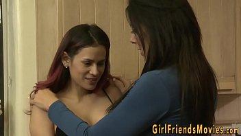 Busty lesbian rubbing her pussy