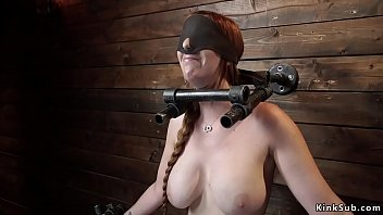 Busty shackled slave gets whipped
